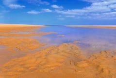 Sandy beach under blue sky I Royalty Free Stock Photos