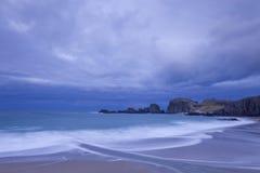 Sandy beach under cloudscape. Scenic view of sandy beach under blue sky and cloudscape Stock Photo