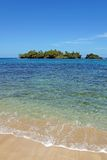 Sandy beach with unspoiled island. Sandy beach with an unspoiled tropical island in background Stock Image