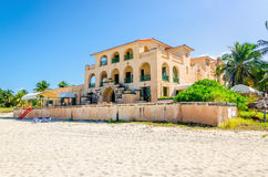 Sandy beach in Varadero with amazing old villa Royalty Free Stock Photography