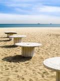 Sandy beach. Varna, Bulgaria. Sandy beach and wooden coils as beach little tables. Varna, Bulgaria Stock Images