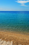 Sandy beach vertical. Vertical oriented picture of a sandy beach in greece stock photos