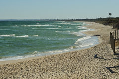Sandy beach in Victoria. Sandin beach and clear waters in Seaford in Port Phillip Bay, Victoria, Australia in winter time with waves royalty free stock image