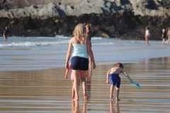 FAMILY WALKING ON THE SAND AT NEWQUAY CORNWALL FISTRAL BEACH stock photography