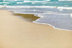 Sandy beach and wave Royalty Free Stock Images