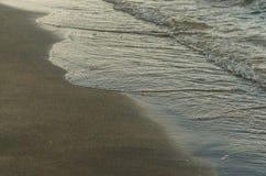 sandy beach with waves stock photo