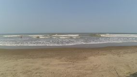 Sandy beach and waves. On the beach in Goa stock footage