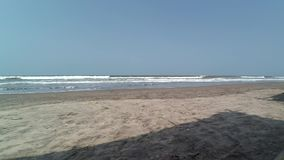 Sandy beach and waves. On the beach in Goa stock video footage