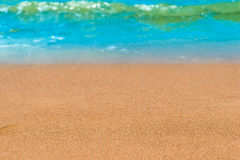 Sandy beach and waves Stock Images