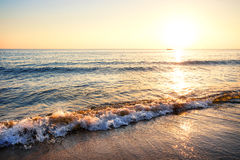 Sandy beach with waves Royalty Free Stock Photography
