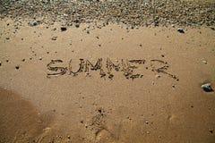 Sandy beach waves at sunset sea summer inscription on the sand. Sandy beach waves at sunset ocean sea summer inscription on the sand Stock Photo