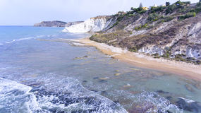Sandy beach by white cliffs of Scala dei Turchi Stock Photography