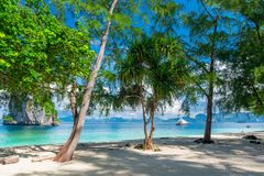 Sandy beach with white sand and trees on the shore Poda island,. Thailand Royalty Free Stock Images