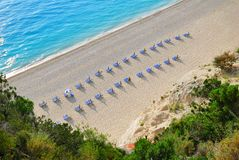 Sandy Beach With Empty Sunbeds From Above Royalty Free Stock Images