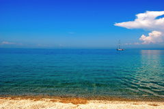 Sandy beach yacht Stock Images