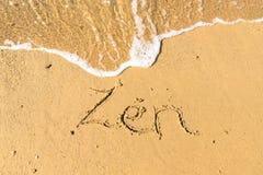 Zen written on sand. Sandy beach with Zen sign scribbled on beach sand. zen meditation concept stock photography