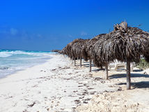Sandy beaches of the Caribbean Sea and sunshades on Cayo Largo's island, Cuba Stock Photography