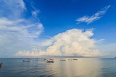 Sandy beaches and colorful fishing boats. Stock Photos