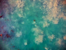 Sandy blue sea and kelp in California shot from above, from the sky. Blue pacific ocean water and bubbling sand shot form above, from the sky, from the air on Royalty Free Stock Photos