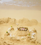 Sandy castle on the beach Stock Images