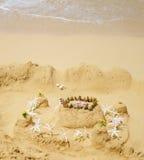 Sandy castle on the beach. Sandy castle with tropical flowers on the beach in Hawaii, Kauai Stock Images