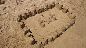 Sandy castle on the sandy beach Royalty Free Stock Photo
