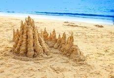 Sandy castle at the sea edge Stock Image