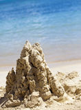 Sandy castle at the sea edge Royalty Free Stock Photography