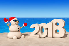 Sandy Christmas Snowman at Sunny Beach with 2018 New Year Sign. Stock Images