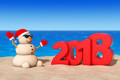 Sandy Christmas Snowman at Sunny Beach with 2018 New Year Sign. Royalty Free Stock Photo