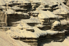 Sandy cliff. Unusual forms formed as a result of erosion of sandy cliff  at coast of gulf Kurshskiy Stock Photo