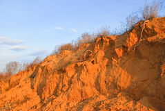 Sandy cliff on the banks of the river Stock Photos