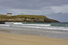 Sandy coast with single house in scotland Royalty Free Stock Images