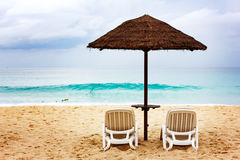Sandy coastine with chaise-longue. Resort beach concept royalty free stock photography