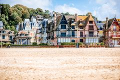 Sandy coastline with buildings in Trouville, France royalty free stock images
