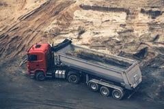 Construction Site Dump Truck. Sandy Construction Site Large Dump Truck. Moving Dirt Royalty Free Stock Photo