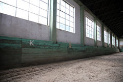 Sandy covering abandoned training arena for riders and horsemen Royalty Free Stock Photo