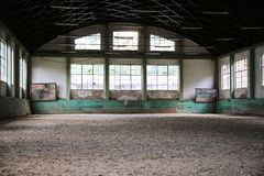 Sandy covering abandoned training arena for riders and horsemen Royalty Free Stock Image