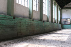 Sandy covering training arena for riders and horsemen. Abandoned riding hall without horses and horsemen Stock Image