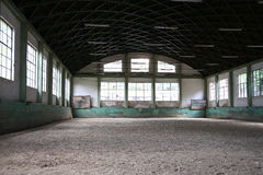 Sandy covering training arena for riders and horsemen Royalty Free Stock Images