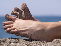 Sandy crazy woman toes on the beach. Sandy crazy woman toes moving and relaxing on the beach Royalty Free Stock Photography