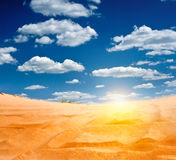 Sandy desert. With the rising sun on the horizon Stock Images