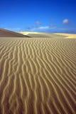 Sandy desert. Sandy dunes in desert and cloudy sky Royalty Free Stock Image