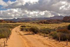 Sandy desert road in South Afr. Landscape -sandy desert road in South Africa Stock Images