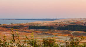 Sandy dunes during sunset. Curonian Spit, Lithuania Stock Photography