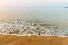 Sandy empty beach and the Ocean Royalty Free Stock Images