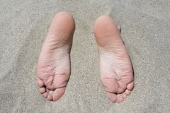 Sandy feet royalty free stock photography