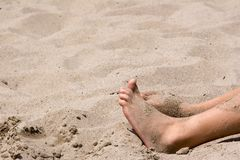 Sandy Feet. Feet at the beach and covered with sand Royalty Free Stock Photo