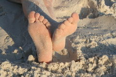 Sandy Feet. Sandy kids feet on beach stock photography