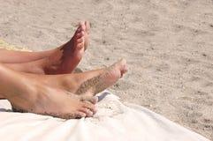 Sandy feet on the beach Royalty Free Stock Photos